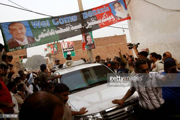 Former Pakistani Prime Minister and head of Pakistan People's Party Benazir Bhutto departs the village of a PPP supporter killed in the Karachi...