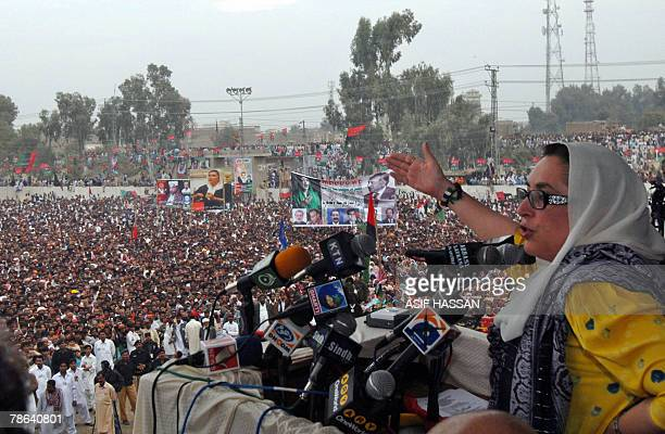 Former Pakistani prime minister Benazir Bhutto addresses the crowd during an election campaign meeting in Larkana, 23 December 2007. After one of the...