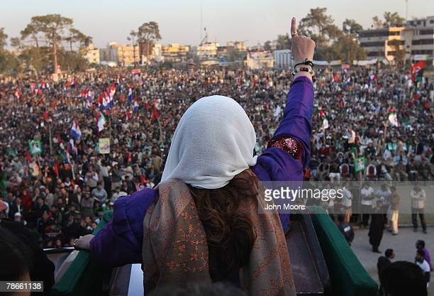 Former Pakistani Prime Minister Benazir Bhutto addresses thousands of supporters at a campaign rally minutes before she was assassinated on December...