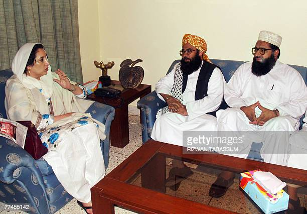 Former Pakistani prime minister Benazir Bhutto gestures during a meeting with Jamiat UlemaeIslam leaders at her residence in Karachi 23 October 2007...