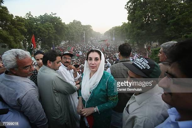 Former Pakistani Prime Minister Benazir Bhutto poses for a photograph whilst on the Pakistani Peoples Party bus on her welcome home parade on October...