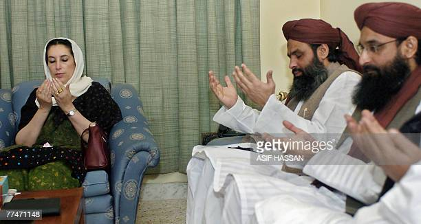 Former Pakistani prime minister Benazir Bhutto prays with Sunni Muslim party leaders in Karachi 22 October 2007 in memory of those killed in a deadly...