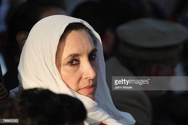 Former Pakistani Prime Minister Benazir Bhutto sits on stage at a campaign rally minutes before she was assassinated in a bomb attack December 27,...