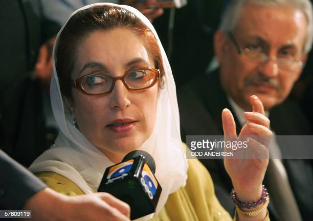 Former Pakistani Prime minister Benazir Bhutto speaks while former Pakistani Prime Minister Nawaz Sharif listens in during a meeting in central...
