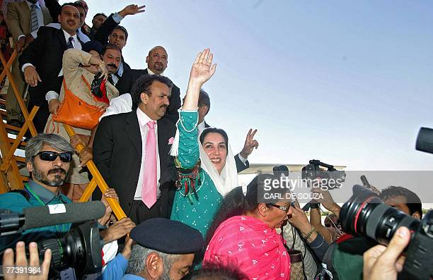 Former Pakistani Prime Minister Benazir Bhutto waves as she lands at Karachi international airport after leaving Dubai 18 October 2007 Bhutto is...