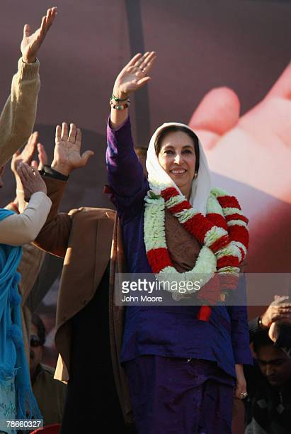 Former Pakistani Prime Minister Benazir Bhutto waves to supporters at a campaign rally minutes before she was assassinated in a bomb attack December...