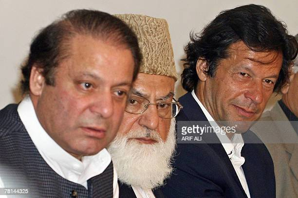 Former Pakistani prime minister Nawaz Sharif sits next to opposition leaders Qazi Hussain Ahmed and Imran Khan as he presides an All Parties...