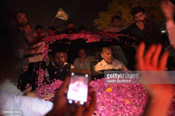 Former Pakistani primer minister Nawaz Sharif sits in a vehicle alongside his younger brother Shahbaz Sharif following his release from Adiala prison...