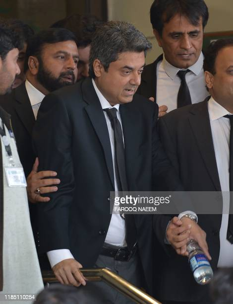 Former Pakistan's law and justice minister Mohammad Farogh Naseem leaves the Supreme Court building after a break of a case hearing suspending the...
