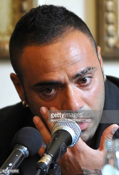 Former Palermo's capitain Fabrizio Miccoli talks on June 27 2013 during a press conference in Palermo over reports he insulted a judge Giovanni...