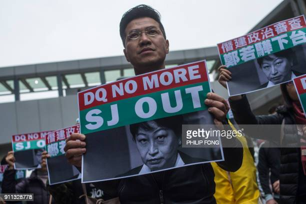 Former pandemocracy lawmaker Gary Fan holds a poster of Secretary for Justice Teresa Cheng during a protest in Hong Kong on Januray 28 2018...