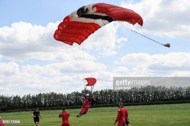 Former paratrooper Fred Glover comes into land during a skydive at the Old Sarum airfield on August 10, 2017 in Salisbury, England. Chelsea Pensioner...