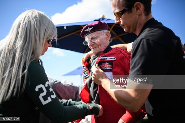 Former paratrooper Fred Glover gets into his jumpsuit ahead of his skydive at the Old Sarum airfield on August 10, 2017 in Salisbury, England....