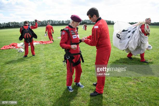 Former paratrooper Fred Glover is released from his harness following a skydive at the Old Sarum airfield on August 10, 2017 in Salisbury, England....
