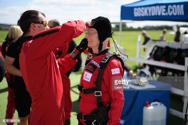 Former paratrooper Fred Glover receives final equipment adjustments ahead of a skydive at the Old Sarum airfield on August 10 2017 in Salisbury...