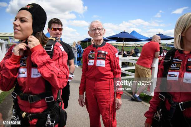 Former paratrooper Fred Glover waits with other people ahead of a skydive at the Old Sarum airfield on August 10 2017 in Salisbury England Chelsea...