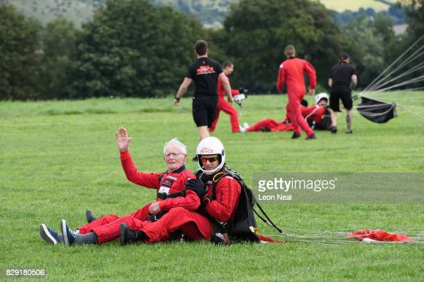 Former paratrooper Fred Glover waves to the media following a skydive at the Old Sarum airfield on August 10 2017 in Salisbury England Chelsea...