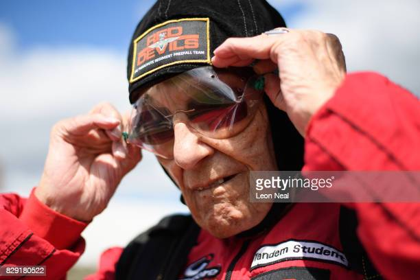 Former paratrooper Ted Pieri checks his goggles before completing a skydive at the Old Sarum airfield on August 10, 2017 in Salisbury, England....