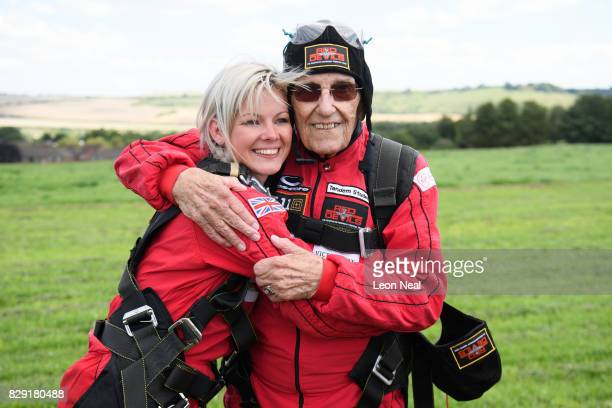 Former paratrooper Ted Pieri hugs his granddaughter after completing a skydive at the Old Sarum airfield on August 10 2017 in Salisbury England...