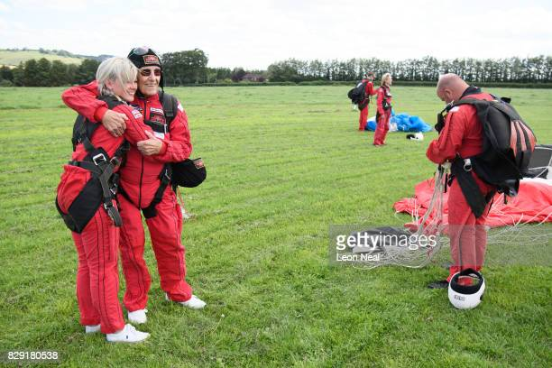 Former paratrooper Ted Pieri hugs his grand-daughter after completing a skydive at the Old Sarum airfield on August 10, 2017 in Salisbury, England....