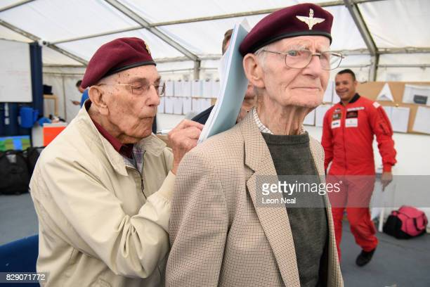 Former paratrooper Ted Pieri signs his waiver form on the back of fellow veteran Fred Glover ahead of their skydive at the Old Sarum airfield on...