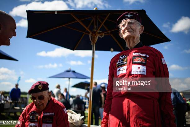 Former paratroopers Ted Pieri and Fred Glover get into their jumpsuits ahead of their skydive at the Old Sarum airfield on August 10 2017 in...