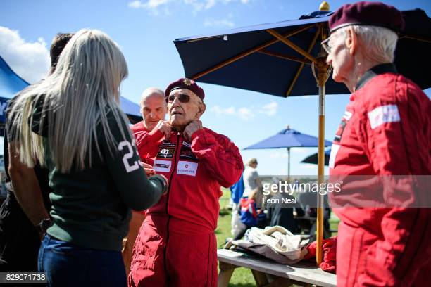 Former paratroopers Ted Pieri and Fred Glover get into their jumpsuits ahead of their skydive at the Old Sarum airfield on August 10, 2017 in...