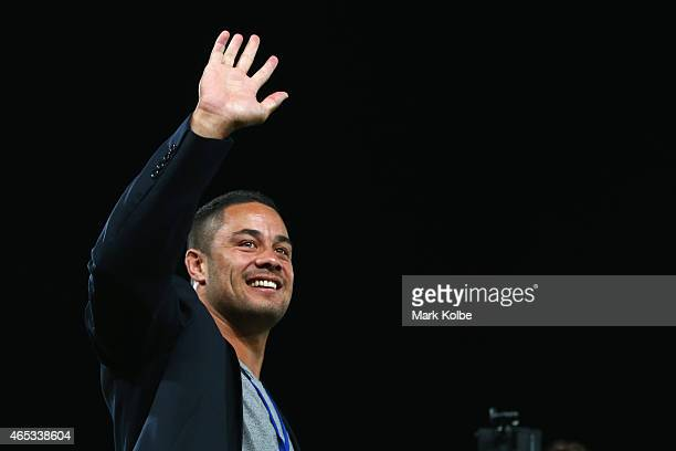Former Parramatta Eel and recent San Francisco 49ers signing Jarryd Hayne waves to the crowd during a halftime presentation in the round one NRL...