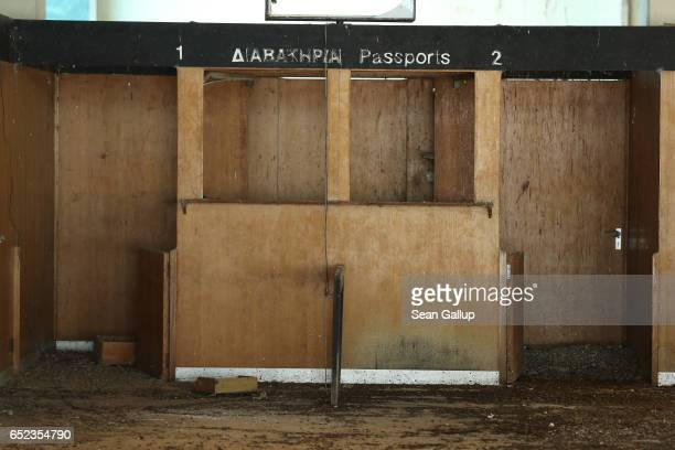 Former passport desk stands decaying in the arrivals hall in the main terminal at Nicosia International Airport inside the buffer zone on the...
