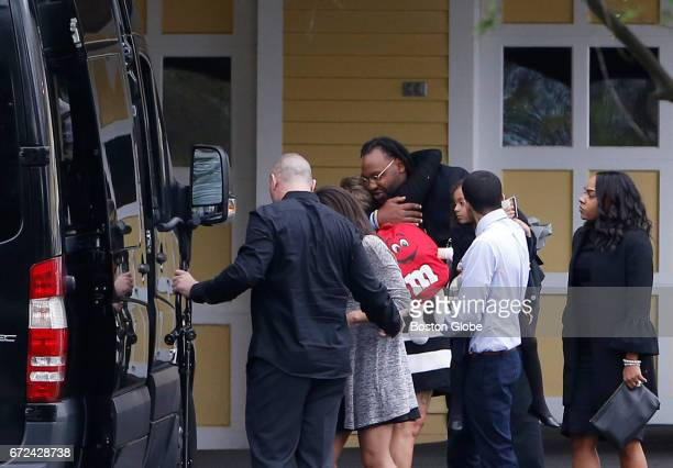 Former Patriots player Brandon Spikes center embraces a woman as he walks beside Shayanna JenkinsHernandez right as they leave O'Brien Funeral Home...