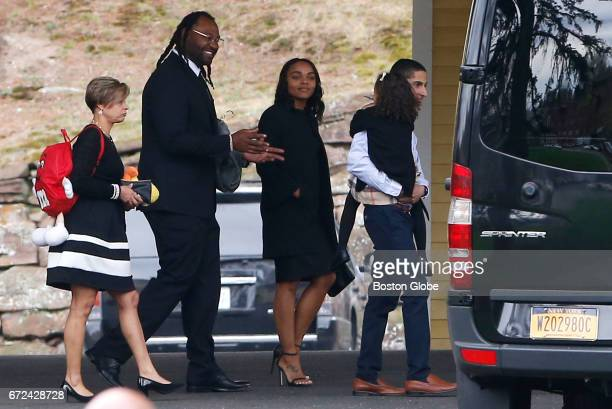Former Patriots player Brandon Spikes second from left walks beside Shayanna JenkinsHernandez as he appears to cheer her daughter up as they leave...