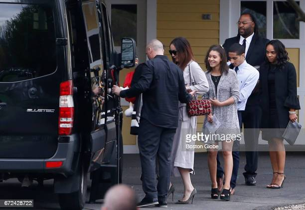 Former Patriots player Brandon Spikes second from right walks beside Shayanna JenkinsHernandez right as they leave O'Brien Funeral Home following...