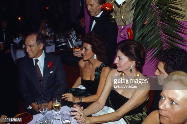 Former Persian Empress Soraya with Canadian Prime Minister Pierre Trudeau at an evening event, 1980s.