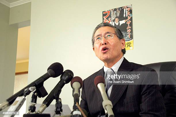 Former Peru President Alberto Fujimori speaks during a press conference after he failed to gain a seat in the Japan's Upper House election on July 30...