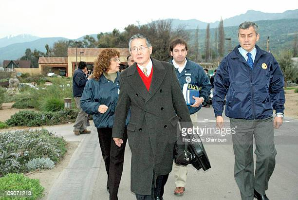 Former Peruvian President Alberto Fujimori leaves his house to be extradited to Peru on September 22 2007 in Santiago Chile