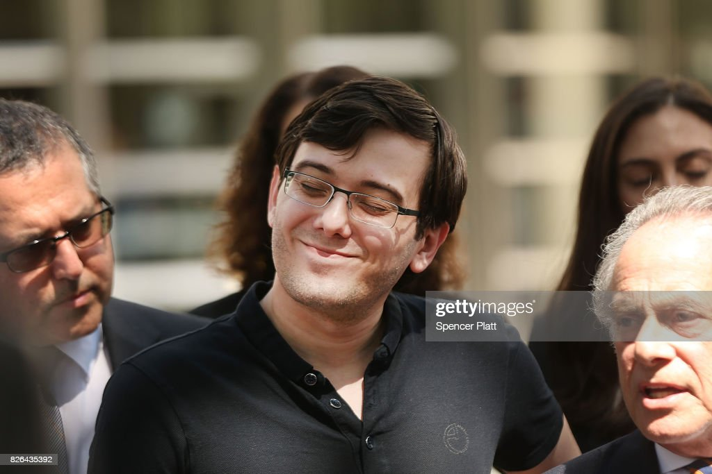 Former pharmaceutical executive Martin Shkreli smiles while speaking to the media in front of U.S. District Court for the Eastern District of New York with members of his legal team after the jury issued a verdict, August 4, 2017 in the Brooklyn borough of New York City. Shkreli was found guilty on three of the eight counts involving securities fraud and conspiracy to commit securities and wire fraud.