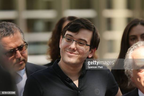Former pharmaceutical executive Martin Shkreli smiles while speaking to the media in front of US District Court for the Eastern District of New York...