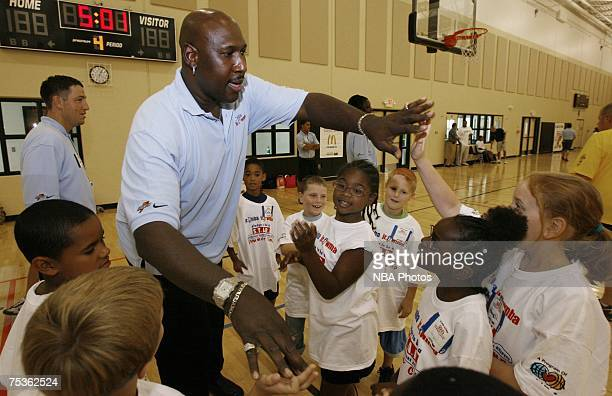 Former Philadelphia 76ers great Daryl Dawkins greets kids during a junior clinic sponsored by the NBA July 11 2007 at Nienhuis Park Community Center...