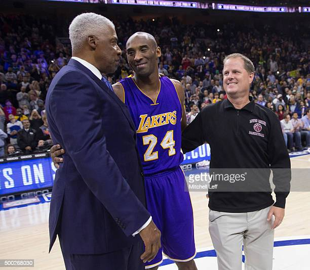 Former Philadelphia 76ers Julius Erving Kobe Bryant of the Los Angeles Lakers and Bryant's Lower Merion High School basketball coach Gregg Downer...