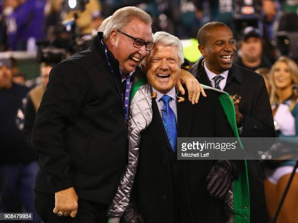 Former Philadelphia Eagle Ron Jaworski and former NFL player and coach Jimmy Johnson embrace on the field prior to the NFC Championship game between...