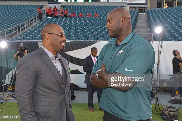 Former Philadelphia Eagles players Donovan McNabb and Tra Thomas talk before the game against the Kansas City Chiefs at Lincoln Financial Field on...