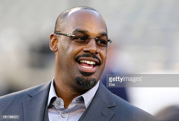 Former Philadelphia Eagles quarterback Donovan McNabb looks on from the field prior to the game between the Eagles and the Kansas City Chiefs at...