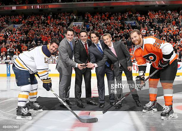 Former Philadelphia Flyer Danny Briere along with his sons Caelan BriereCarson Briere and Cameron Briere drop the puck in a ceremony with Buffalo...