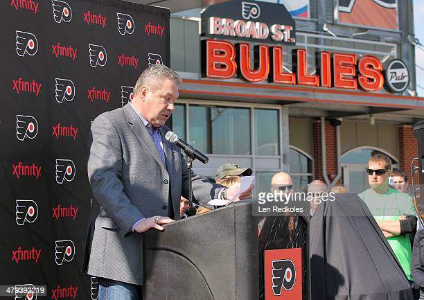 Former Philadelphia Flyer Dave Schultz speaks at the unveiling of a statue of Hockey HallofFamer Fred Shero at Xfinity Live outside of the Wells...