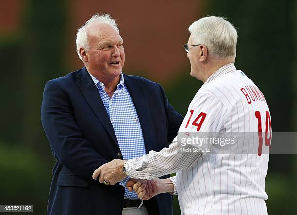 Former Philadelphia Phillies manager Charlie Manuel greets former great Jim Bunning during a ceremony to honor Manuel who was inducted to the...
