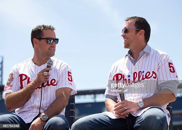 Former Philadelphia Phillies Pat Burrell and Brad Lidge speak during an interview prior to the game against the Atlanta Braves on August 2 2015 at...