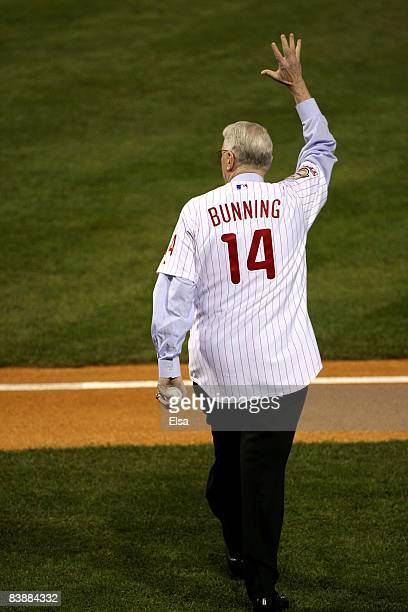 Former Philadelphia Phillies pitcher and US Senator Jim Bunning acknowledges the fans as he walks out to throw the ceremonial first pitch prior to...