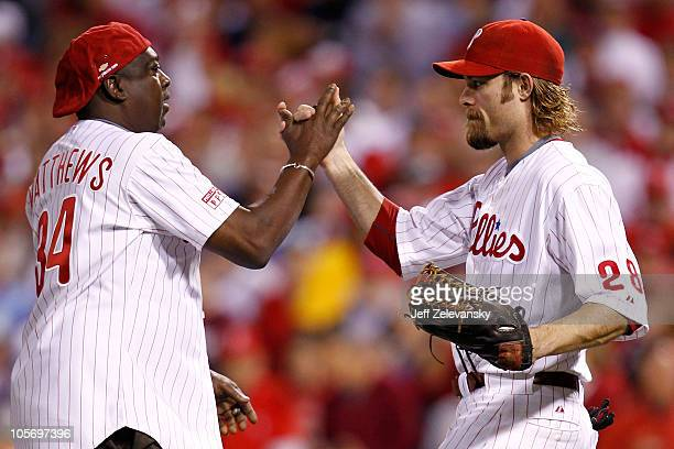 Former Philadelphia Phillies player Gary Matthews Sr is greeted by Jayson Werth after Matthews throws out the first before the Phillies take on the...