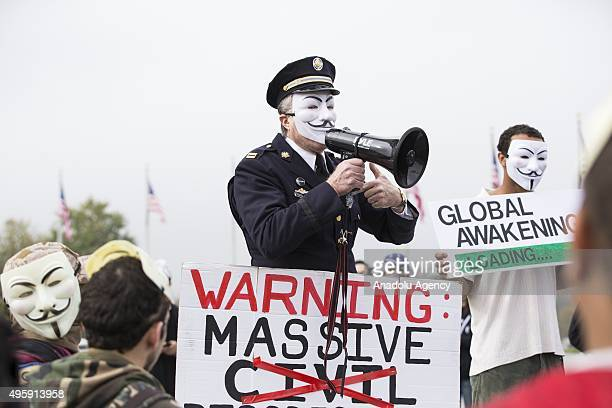 Former Philadelphia Police Officer Ray Lewis wears a Guy Fawkes mask while speaking to the crowd gathered as part of the Anonymous Million Mask March...