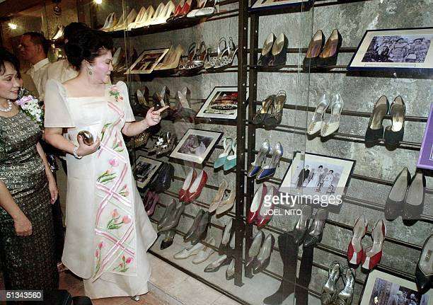 Former Philipnes first lady Imelda Marcos accompanied by tourism official Marides Fernando , looks at her famous shoe collection 16 February 2001...